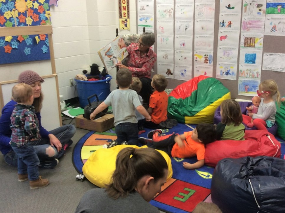Children listening to a story being read