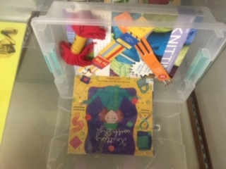 box with books and knitting needles