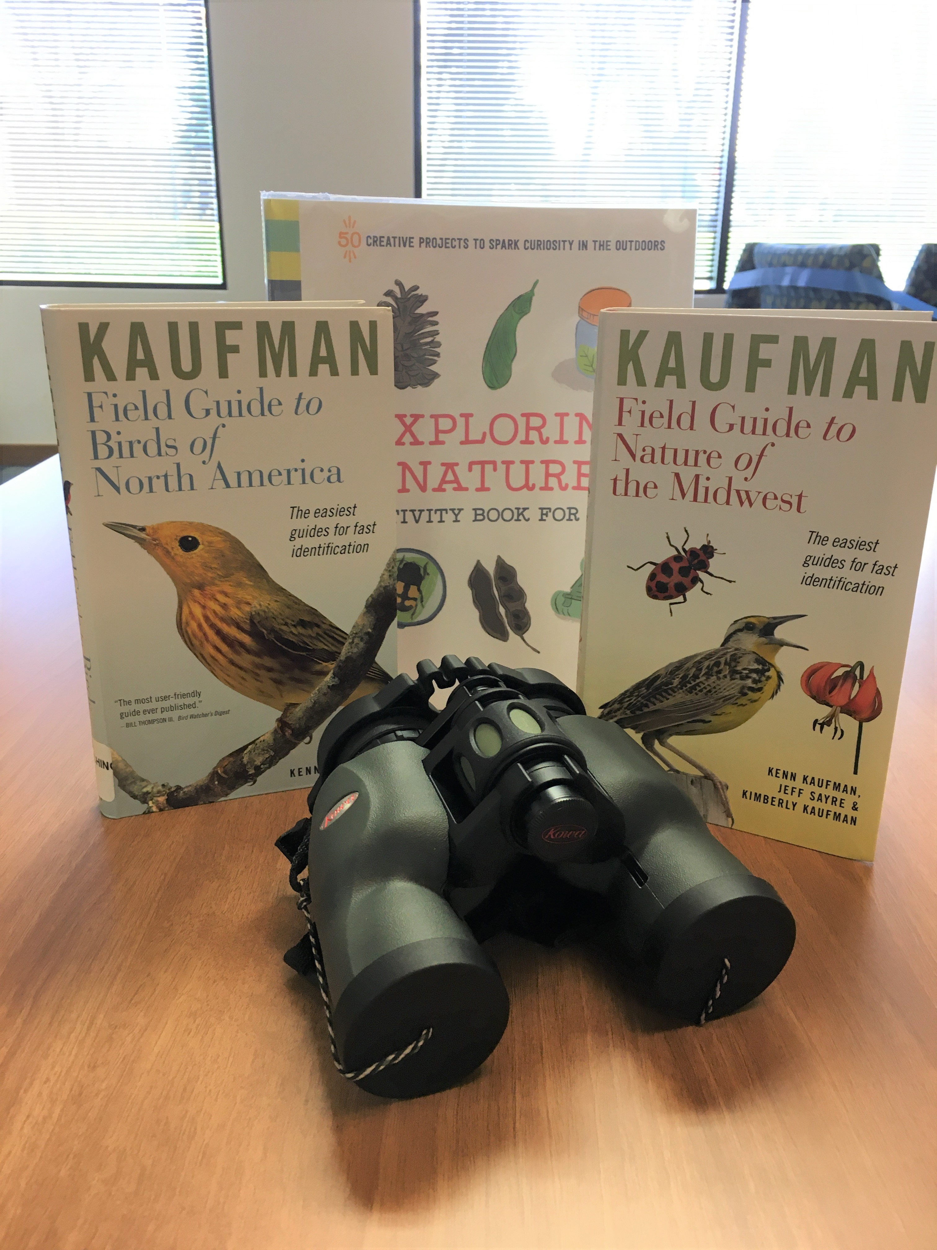 picture of binoculars and bird books